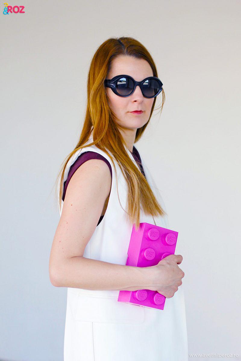 white vest pink clutch
