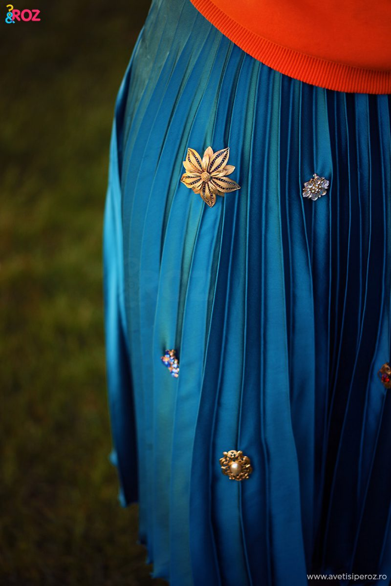 vintage brooch on blue skirt