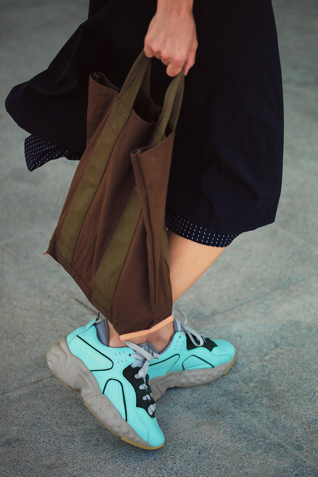 acne chunky sneakers and weekender tote