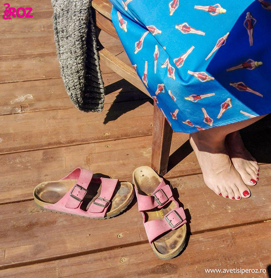 pink birkenstock and blue skirt